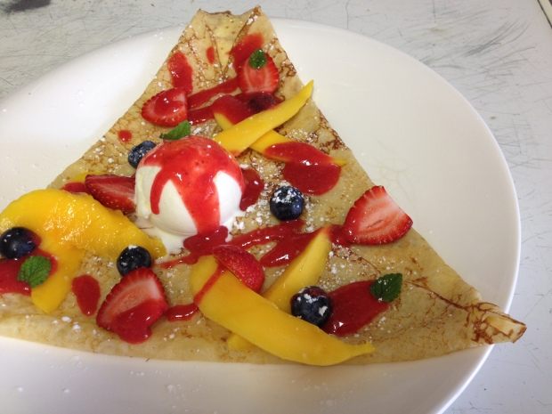Mango. blueberry and strawberry sweet crêpe.